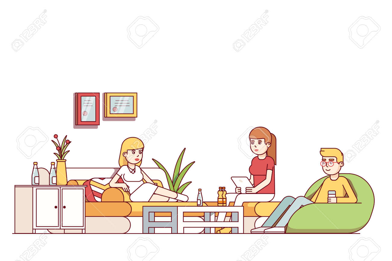 Friends Relaxing In Living Room Or Office Lounge Royalty Free ...