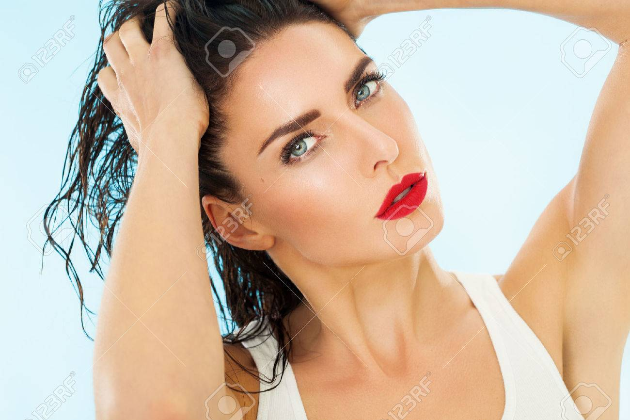 Closeup of a beautiful woman with wet hair. - 35309960