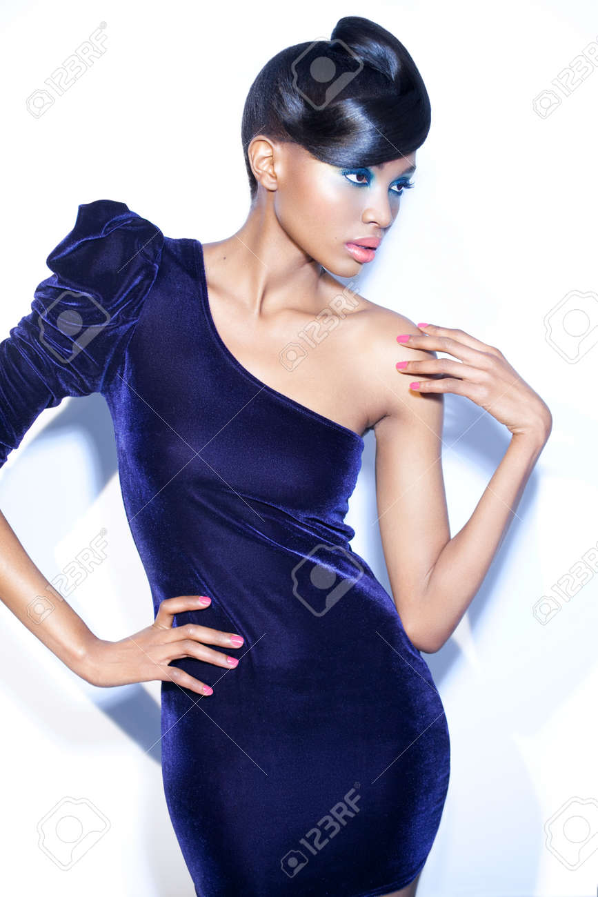 Model posing in dark velvet one-shoulder dress. - 38080962