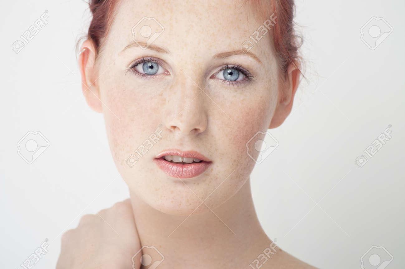 Beautiful fresh Northern European girl with auburn hair, blue eyes and freckles. - 38858964