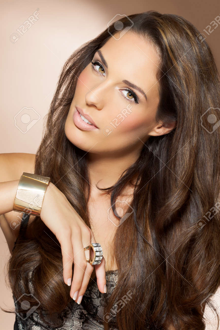 Beautiful woman with long dark hair. Beauty and fashion concept in studio. Shiny locks of groomed hair. - 39588988