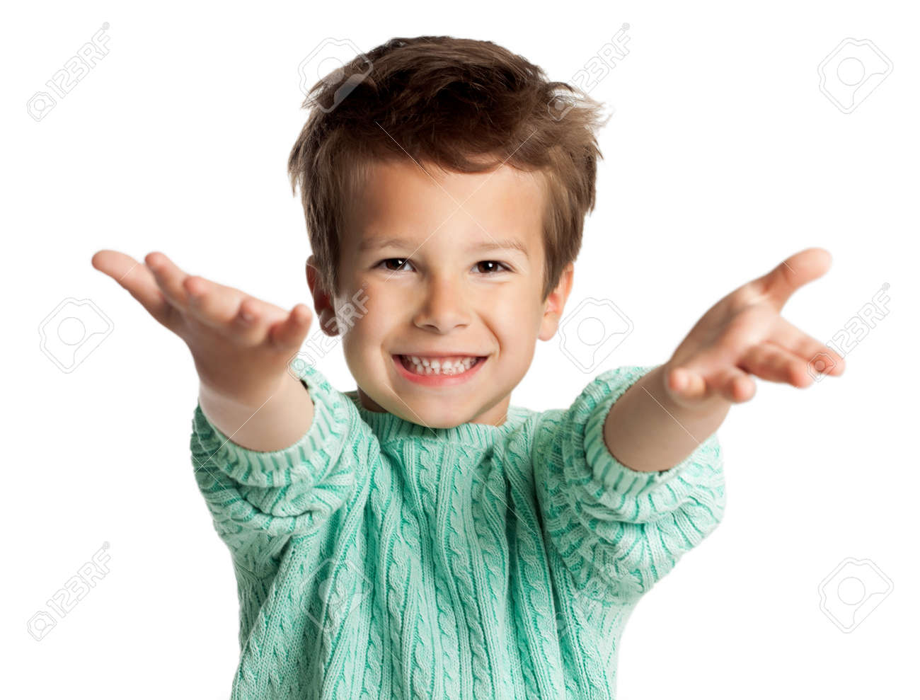 Stylish five year old European boy posing over white studio background. Boy with arms stretched out in welcome gesture. Enthousiastic looking child. - 40763110