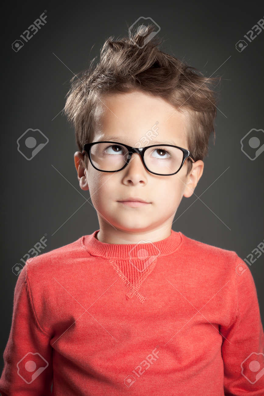 Five year old boy in glasses rolling eyes. Studio shot portrait over gray background. Fashionable little boy. - 44585646