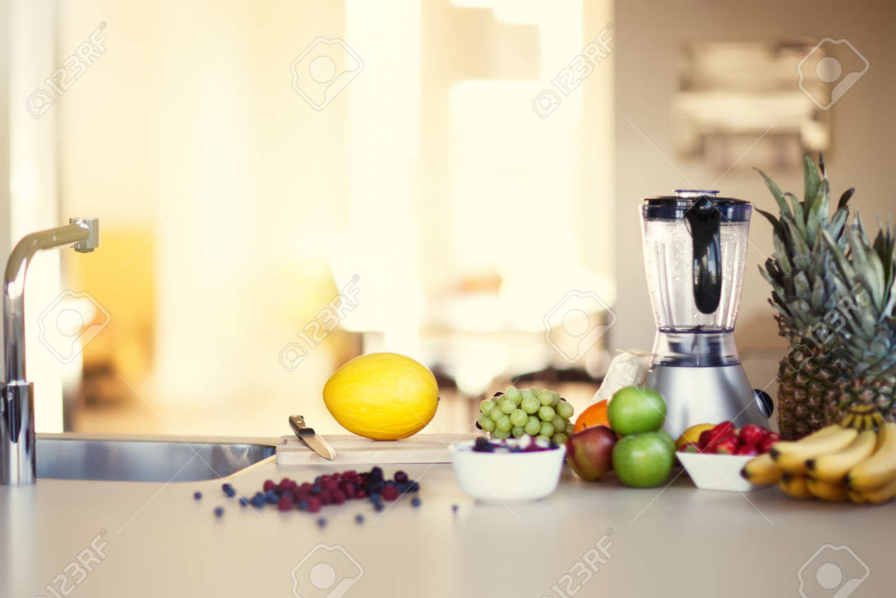 Ingredients for making smoothie in sunny kitchen. Variety of berries and fruit. - 49504256