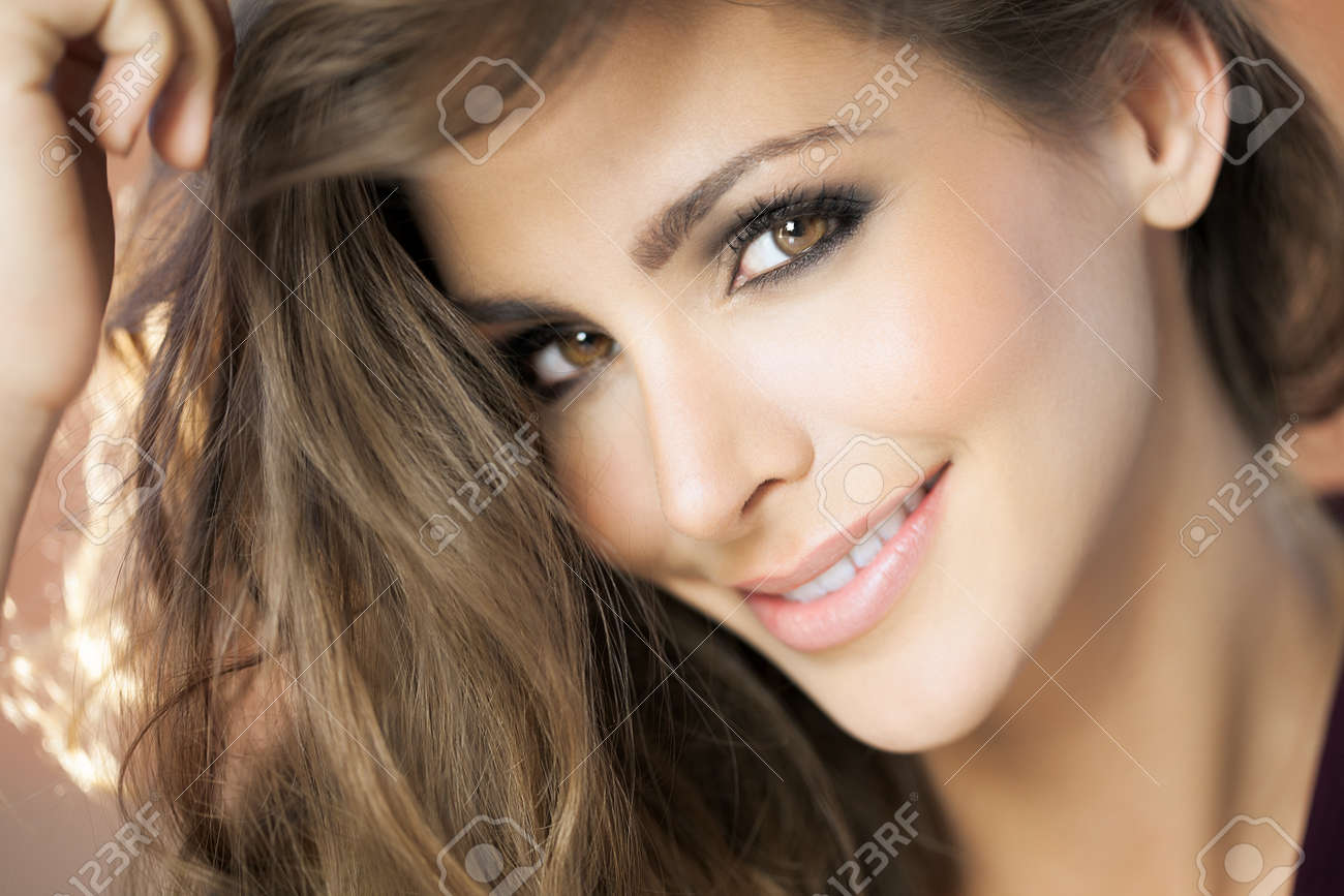 A closeup portrait of a young happy woman with beautiful eyes. Fashion and beauty concept in studio. - 50928221