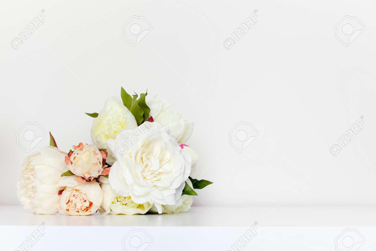 Beautiful peonies bouquet in minimalist indoor setting. - 56478013