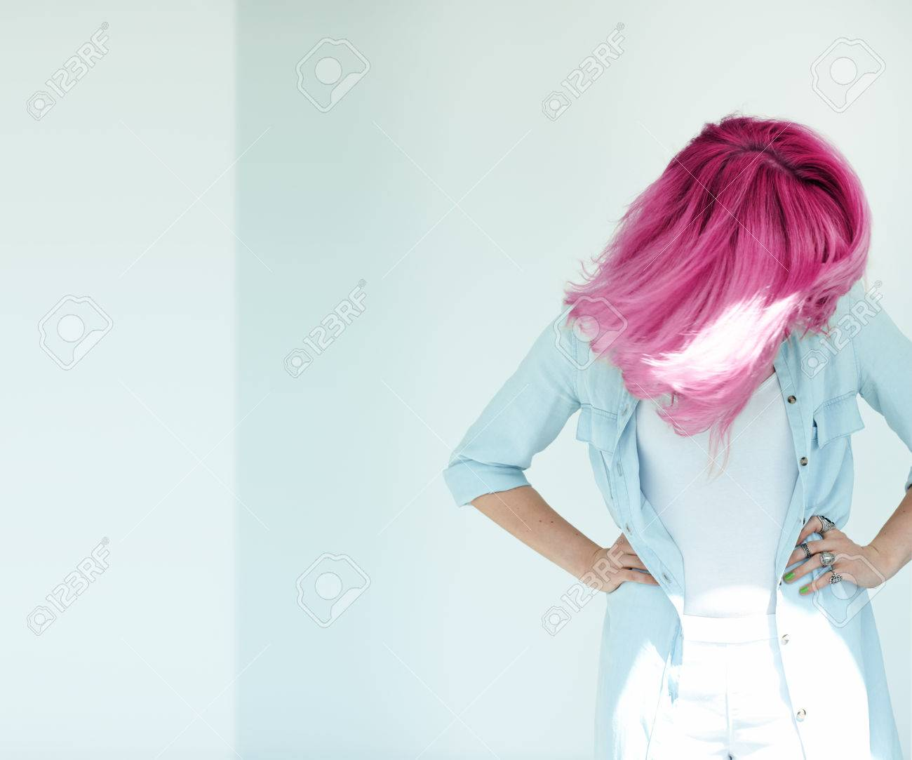 Motion shot of woman's hair. Dyed hair in daylight concept. Beautiful woman with copyspace. - 58629563