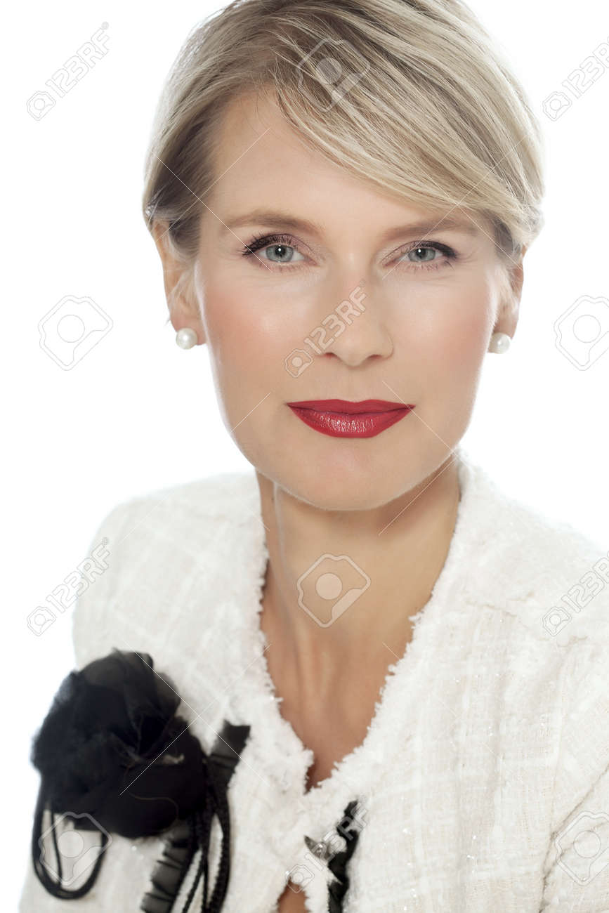 Woman with red lipstick and white jacket. Elegant forty year old woman. - 59035172