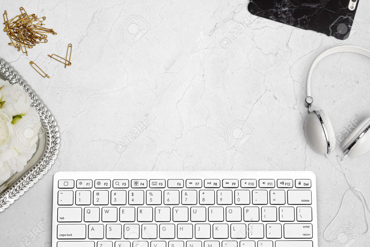 Elegant top view of desk with keyboard, mobile phone and headphones on marble. Styled stock top view mockup scene. - 59851575