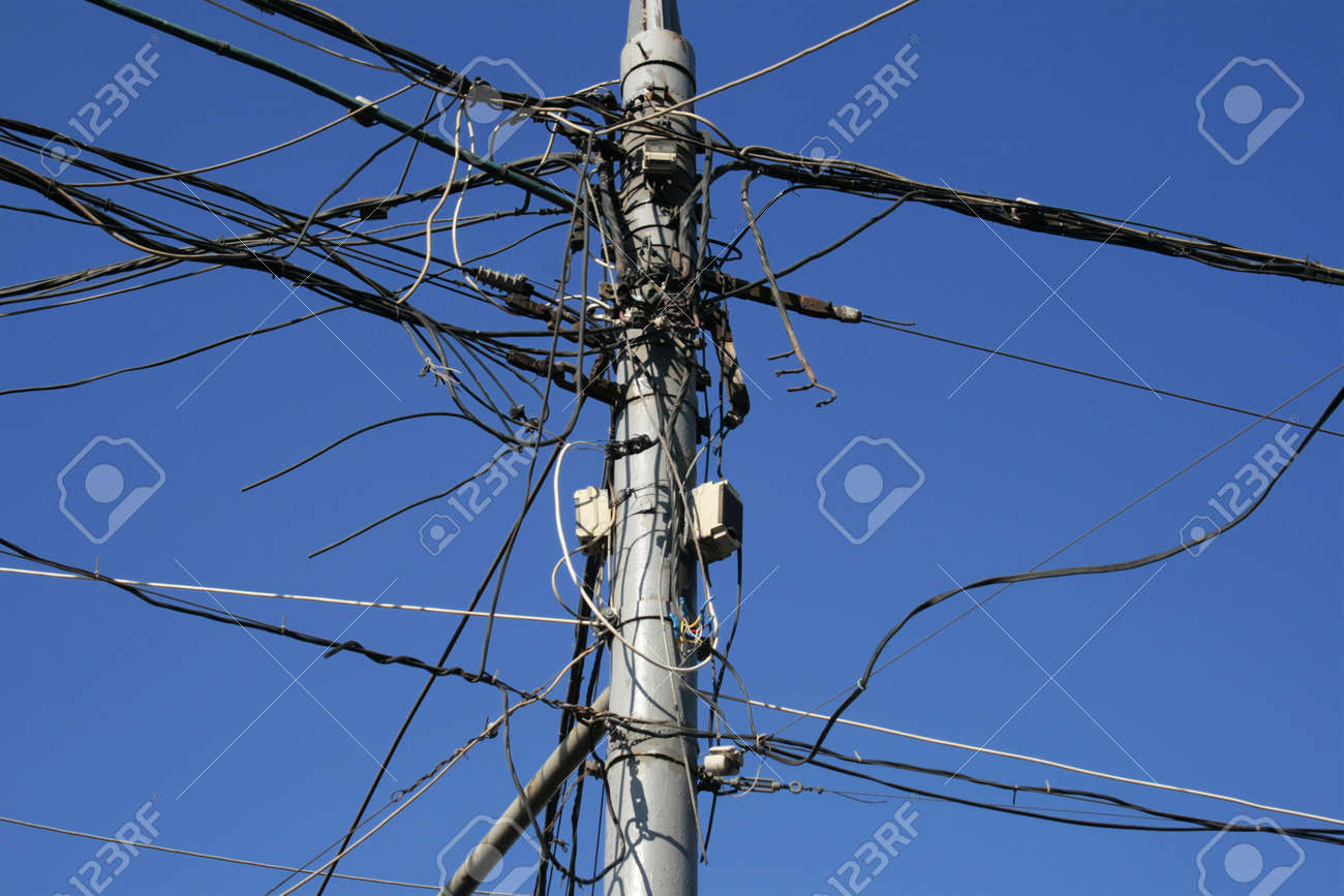 Post And Very Many The Confused Electric Wires On It Stock Photo ...