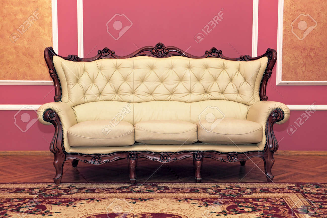 Old antiquarian sofa about a wall Stock Photo - 22063974