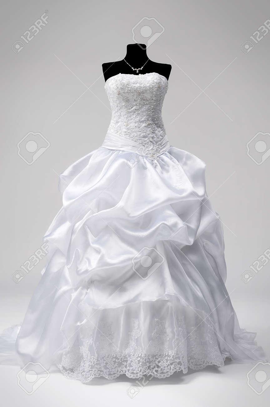 Beautiful snow white bridal dress on a mannequin stock photo beautiful snow white bridal dress on a mannequin stock photo 29345396 junglespirit Choice Image