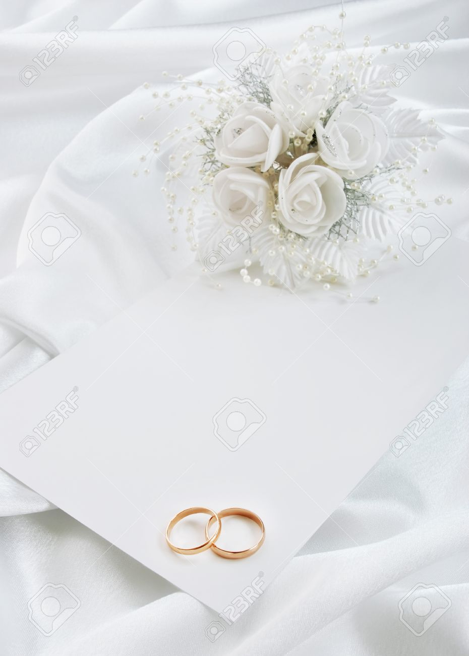 The Wedding Invitation With Wedding Rings And A Bouquet Of The