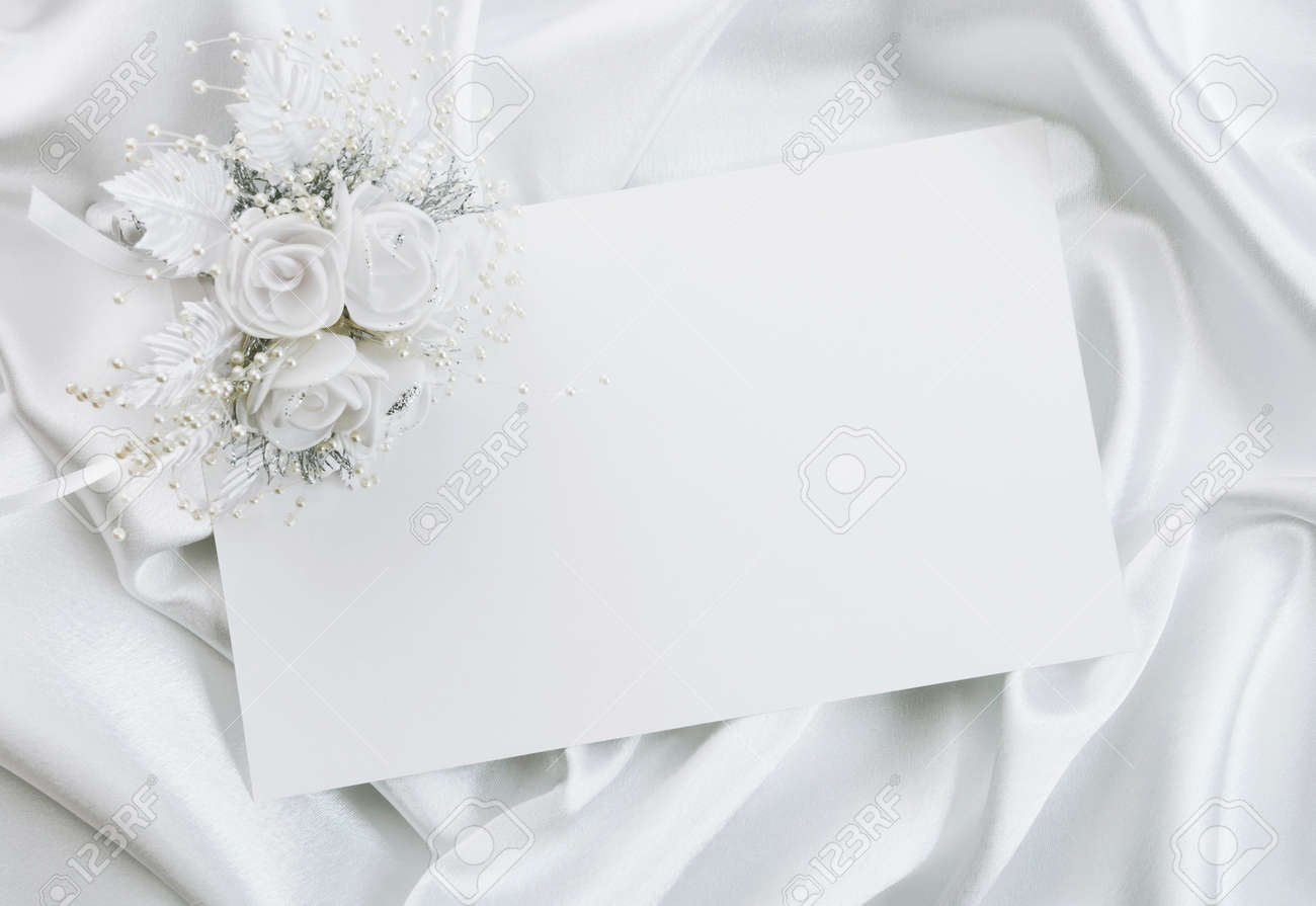 The Wedding Invitation With A Bouquet Of The Bride On A White