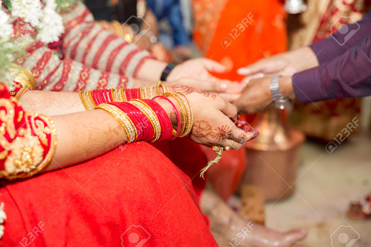 Hindu Nepali Bride and groom's Hands on the wedding day. - 101264893
