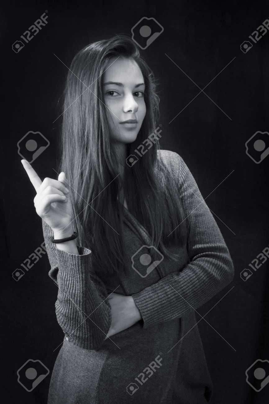 Monochrome close up emotional portrait of young beautiful girl stock photo 77589328