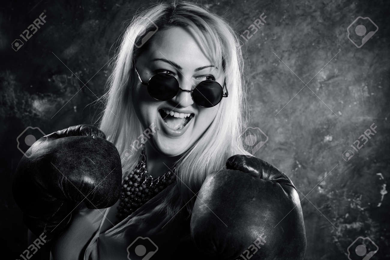 Attractive plump woman with boxing gloves studio portrait. - 159558410