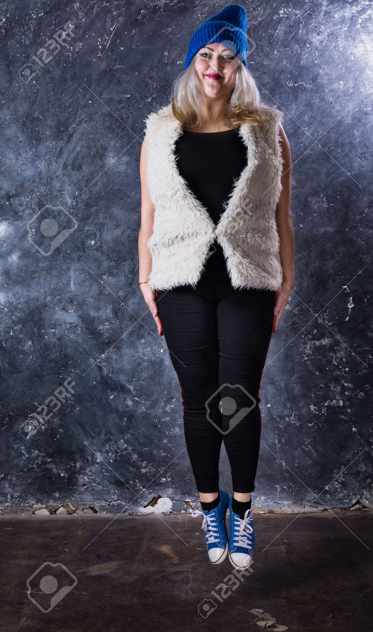 Attractive plump woman dressed in sport style casual - 159153174