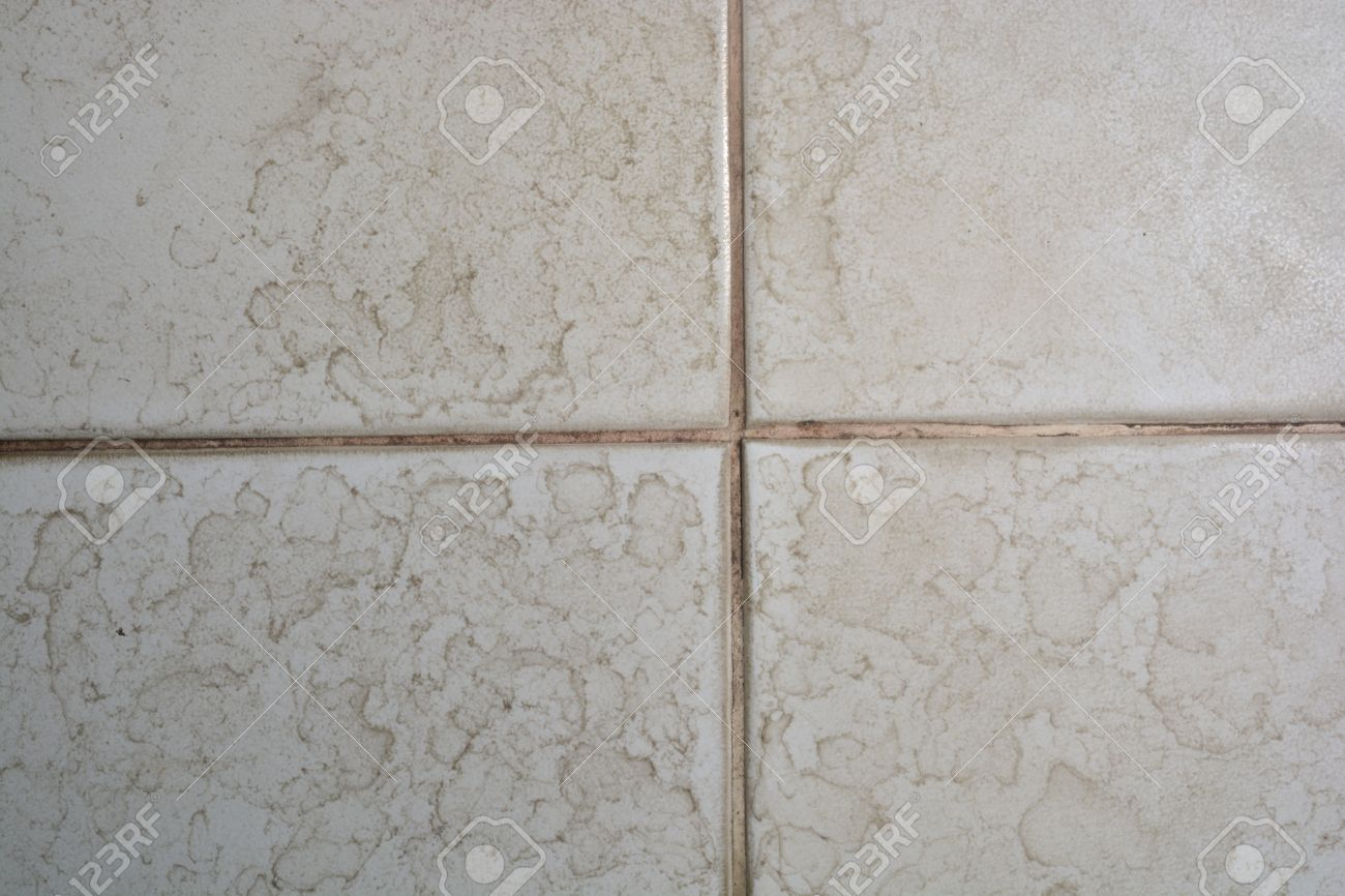 Water stains on walls in bathroom - Close Up Of Bathroom Floor Tile Texture With Water Stain Spot Stock Photo 59016141