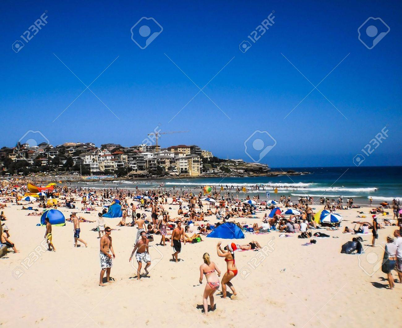 People Relaxing At Bondi Beach On Christmas Day Stock Photo