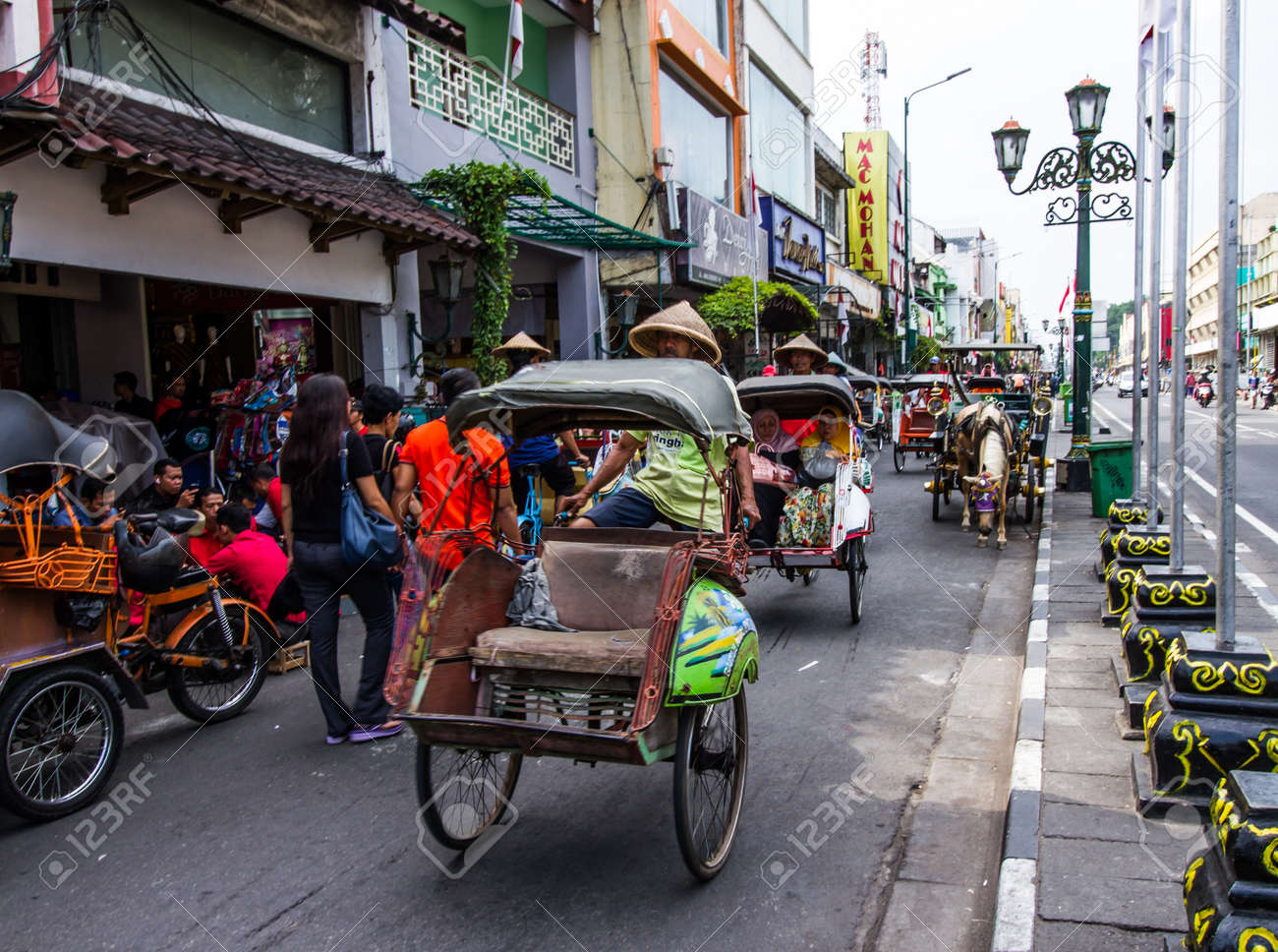 YOGYAKARTA, INDONESIA - AUGUST 27: View of pedicab trishaw tricycle on August 27,2016 in Yogyakarta, Indonesia.This service available for tourist around the city. - 64767399