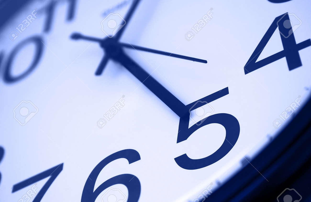 Five o clock - detail of wall office clock showing it's time to go home. Selective focus on number 5, blue tint Stock Photo - 2286599
