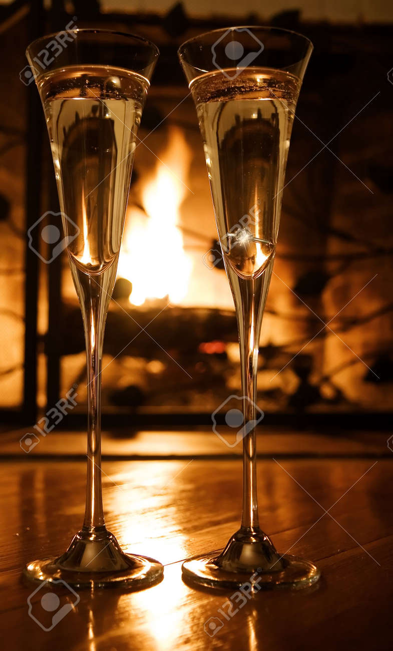 champaine toast by a fireplace