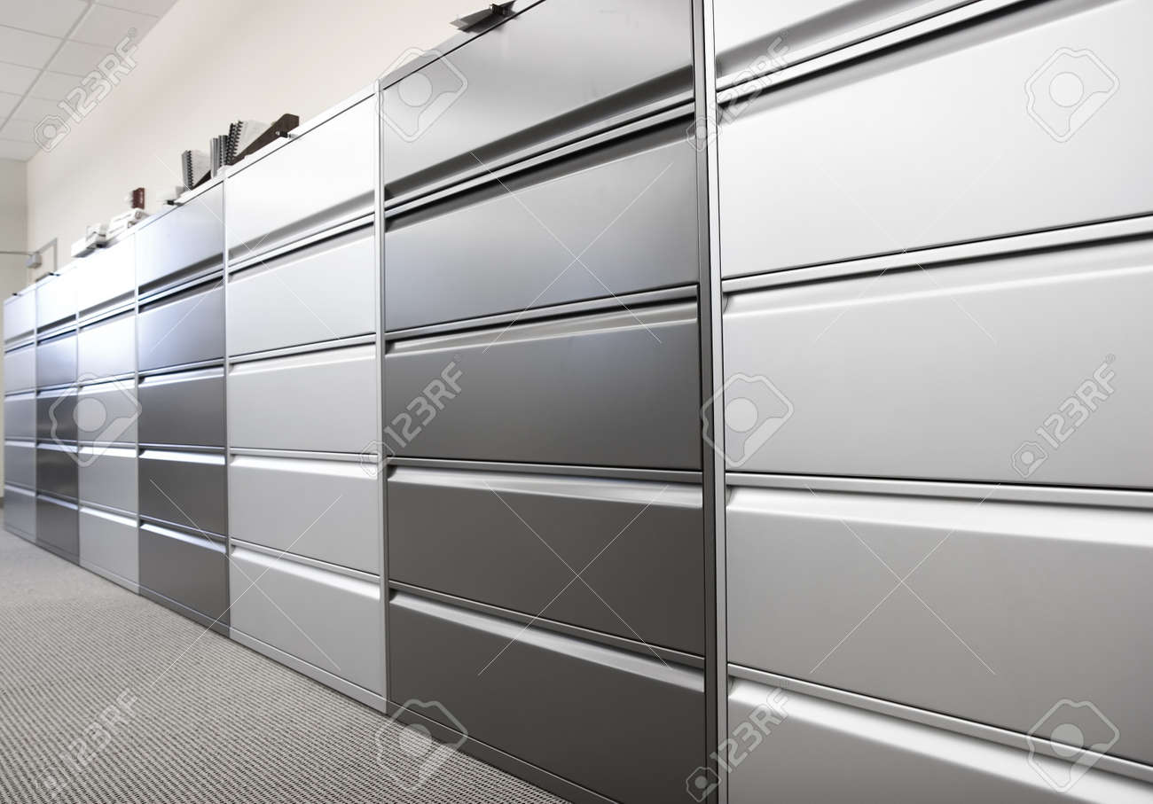 long row of large filing cabinets in an office or hospital stock
