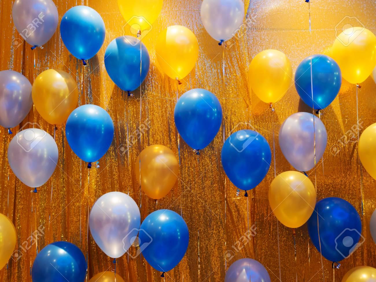 Blue Orange Yellow And White Balloons Decoration On Golden Stock