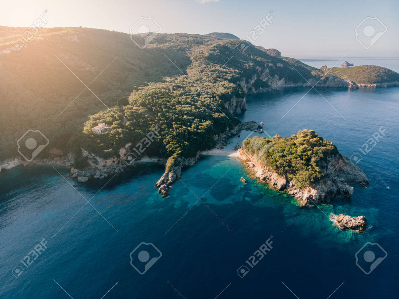 Aerial view of Corfu island. Blue lagoon is flooded with sunlight. - 172285819