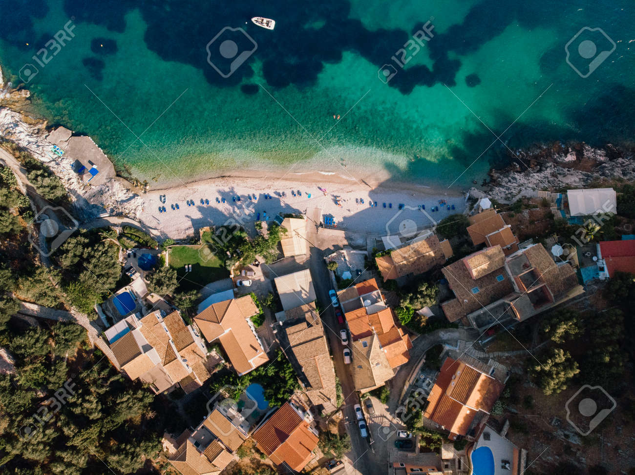 Beautiful beach with turquoise waters near authentic villas. Corfu, Greece. Top-down view. - 172285820