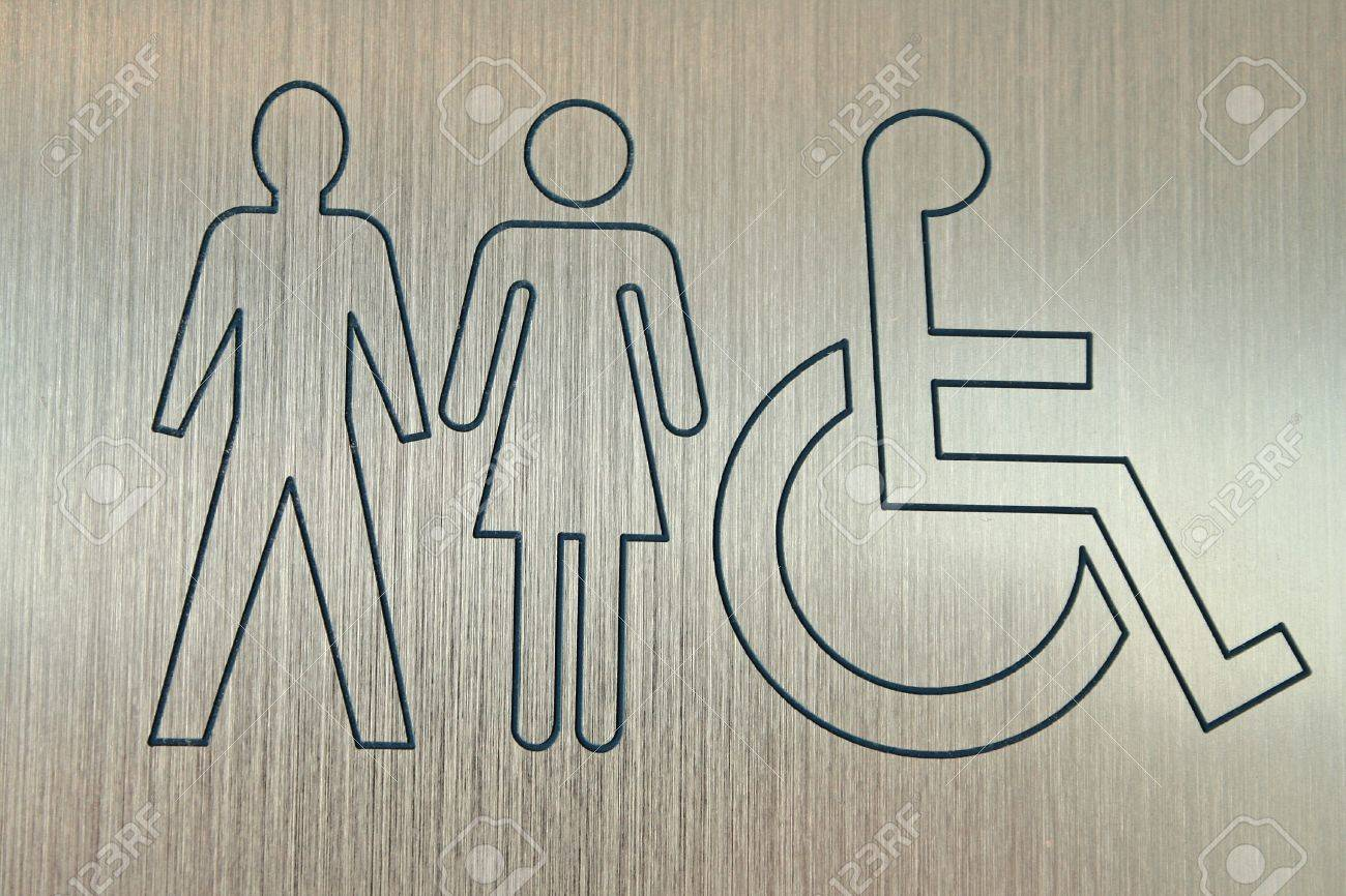 metal sign showing accessible washrooms for men and women Stock Photo - 719569