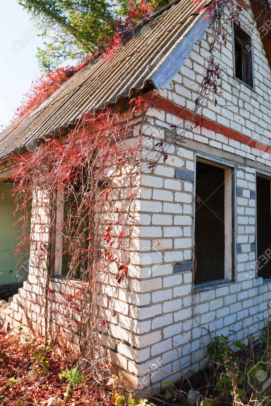 An Old Abandoned Brick House With A Broken Window, Closeup. As ...