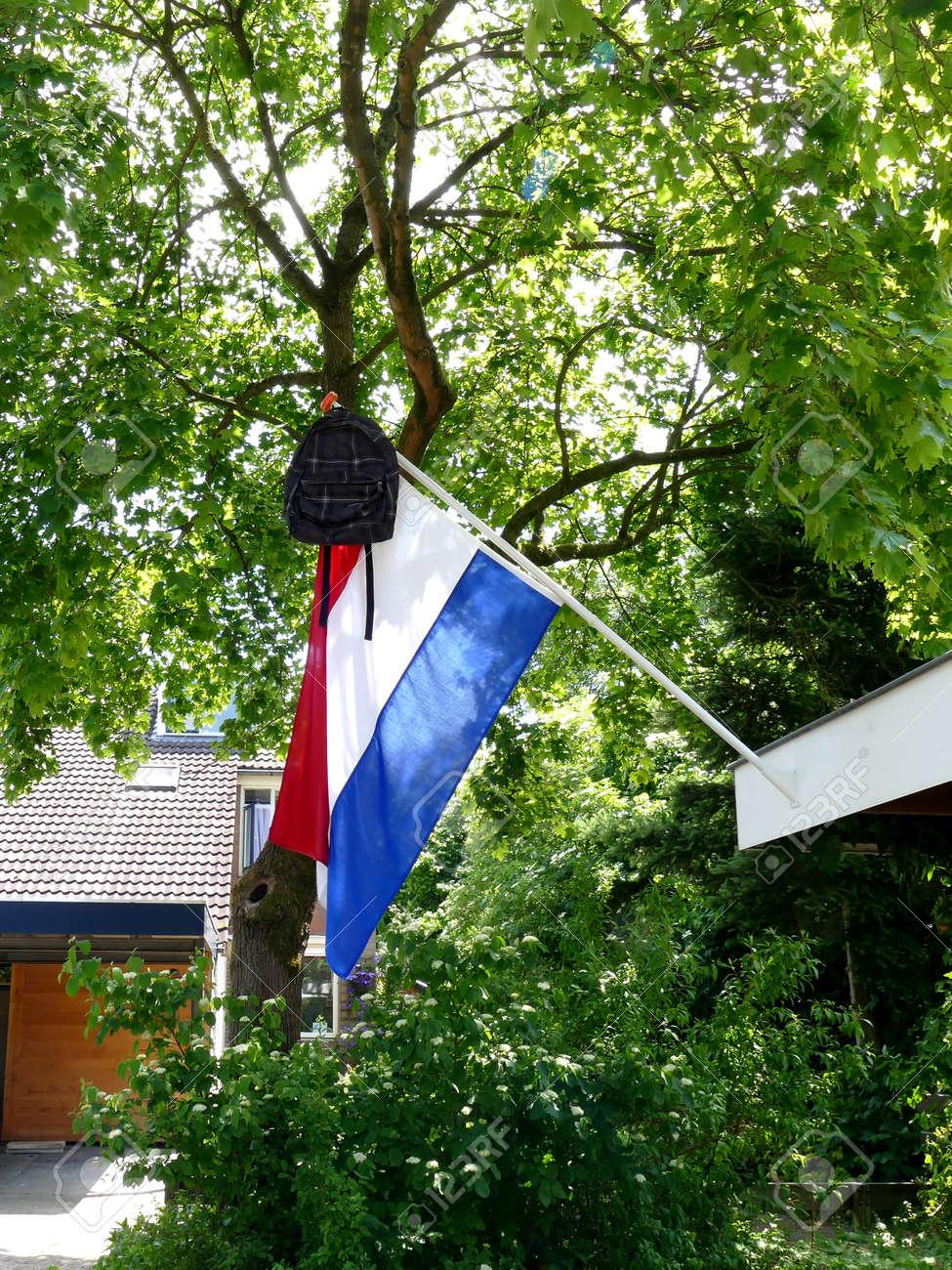 Dutch tradition school bag on flag When graduating - 57885881