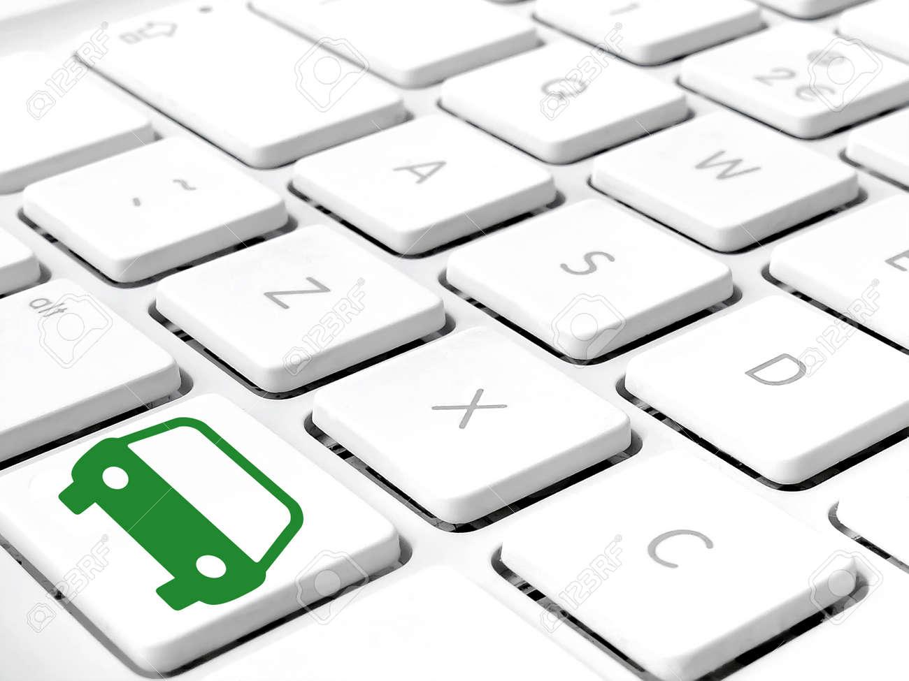 Keyboard White Keys Close Up With Green Car Symbol On Lower Key