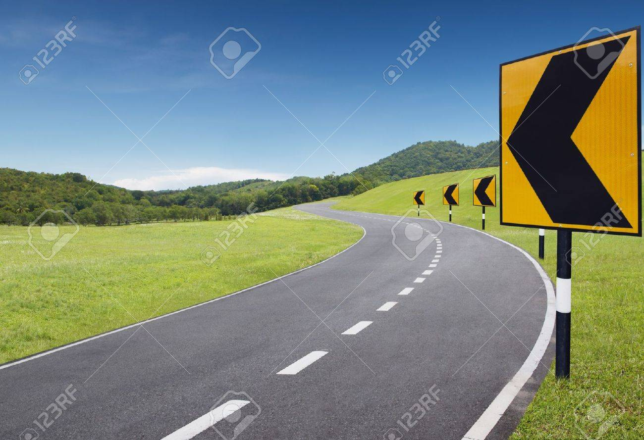 empty curve road with turning left sign Stock Photo - 4550295