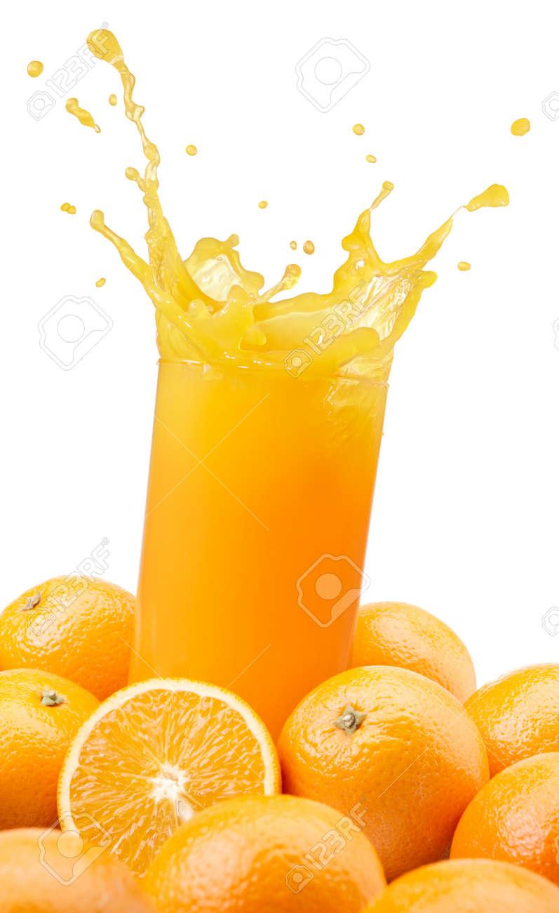 splashing orange juice with oranges against white background Stock Photo - 10081140