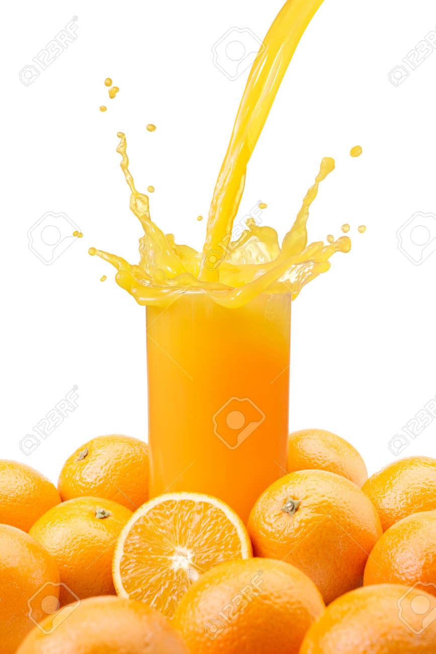 pouring a glass of orange juice creating splash Stock Photo - 10313206