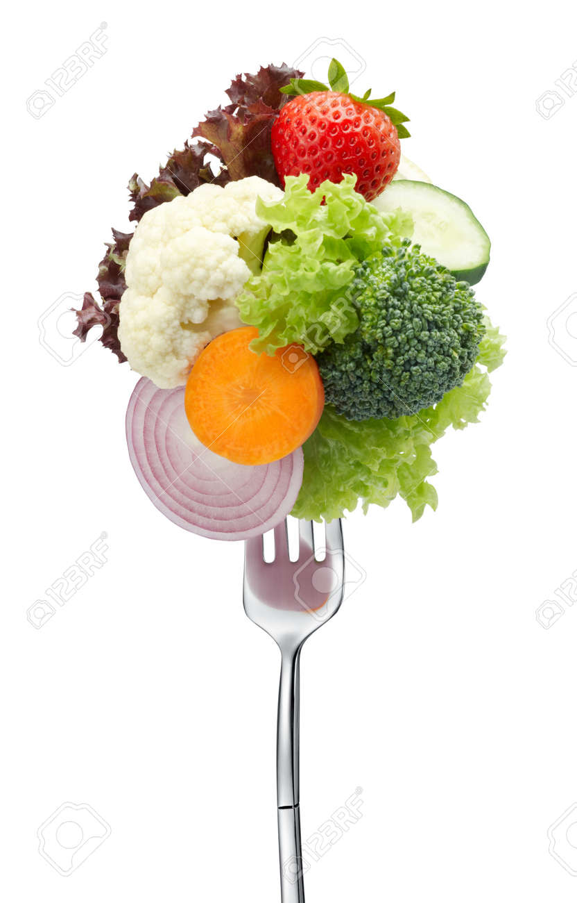 variety of vegetables on fork isolated on white - 10517687