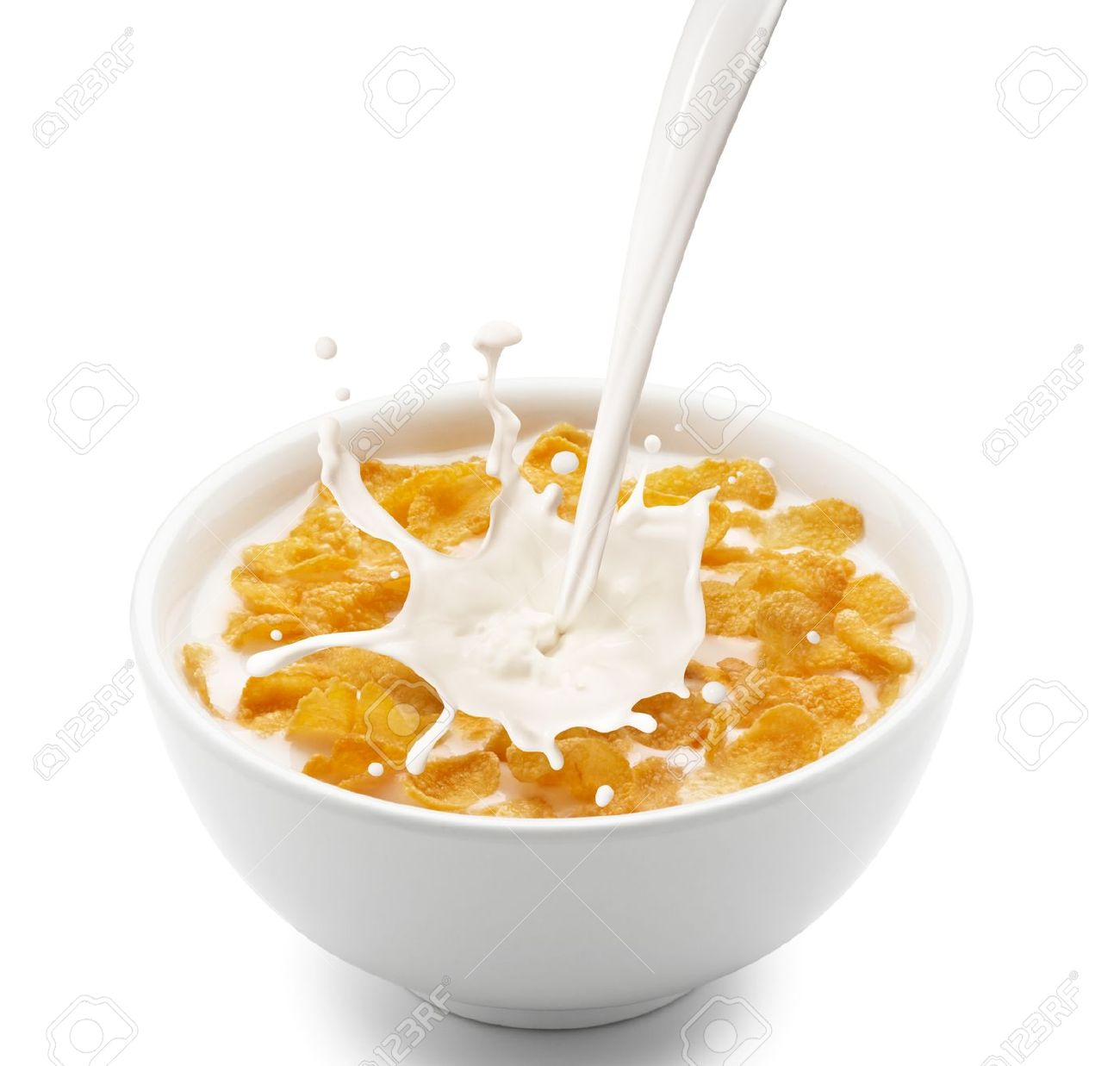 Bowl Of Cornflakes And Milk pouring milk into corn flakes
