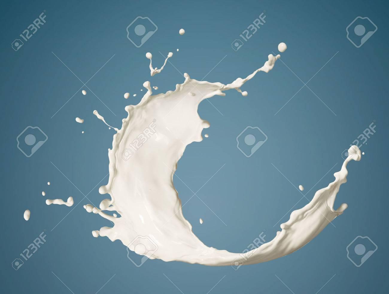 fresh milk splashing isolated on blue background - 36570243