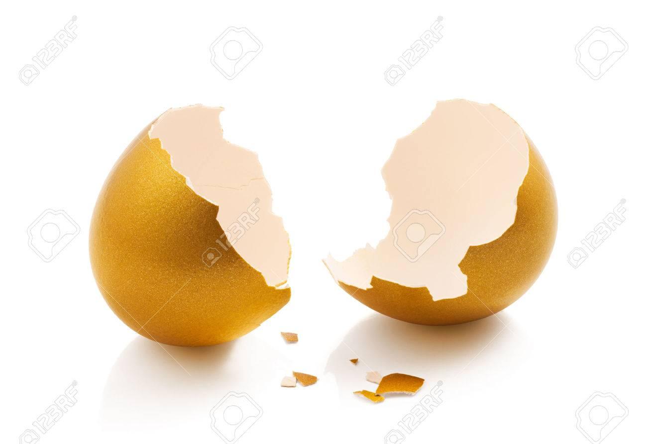 broken golden egg isolated on white background - 37559325