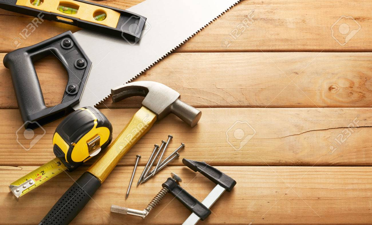 variety of carpentry tools on wood planks with copy space - 43950020