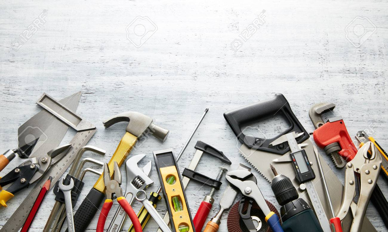 variety of tools on white textured background with copy space - 44218555