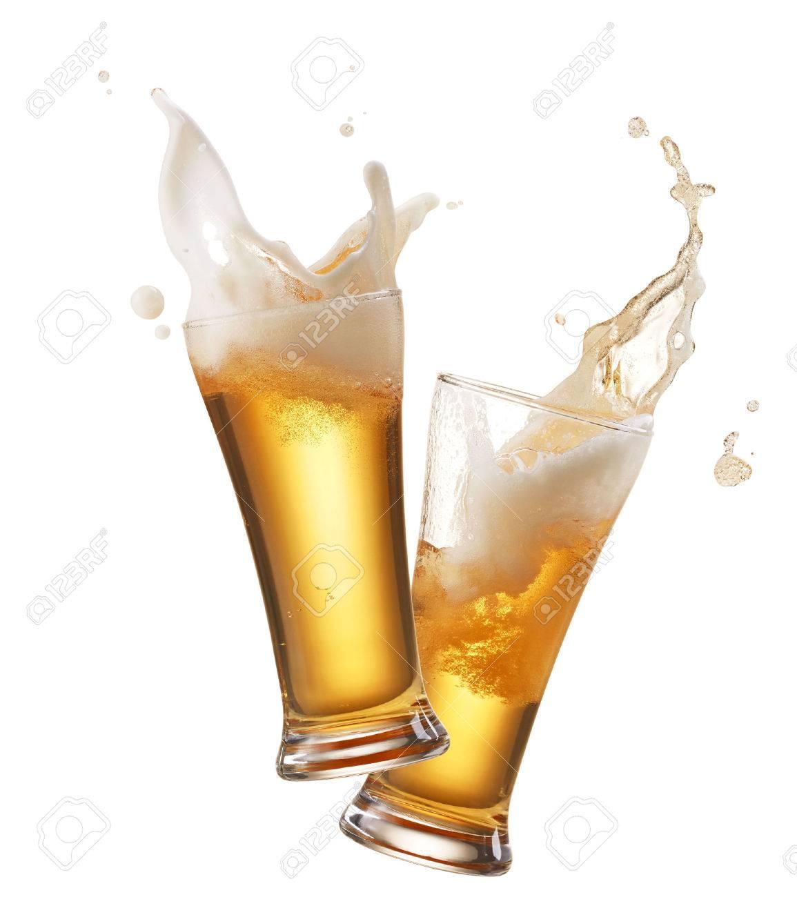 two glasses of beer toasting creating splash - 49136299