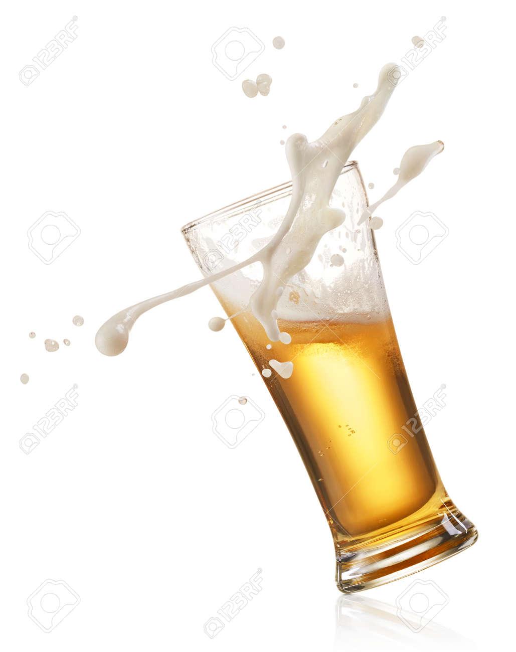 glass of splashing beer isolated on white - 49136301