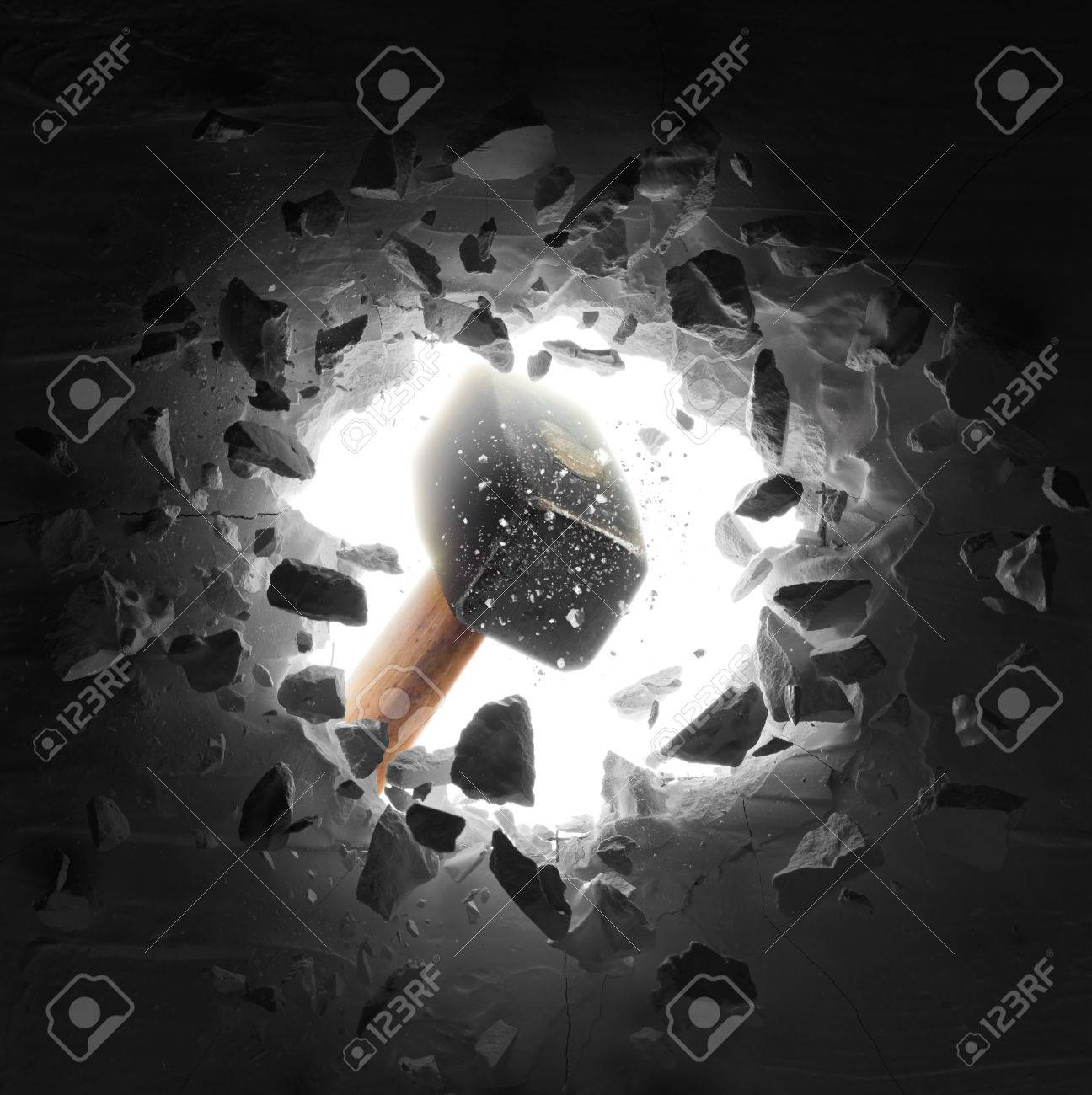 hammer hitting the wall causing hole and debris - 83265537