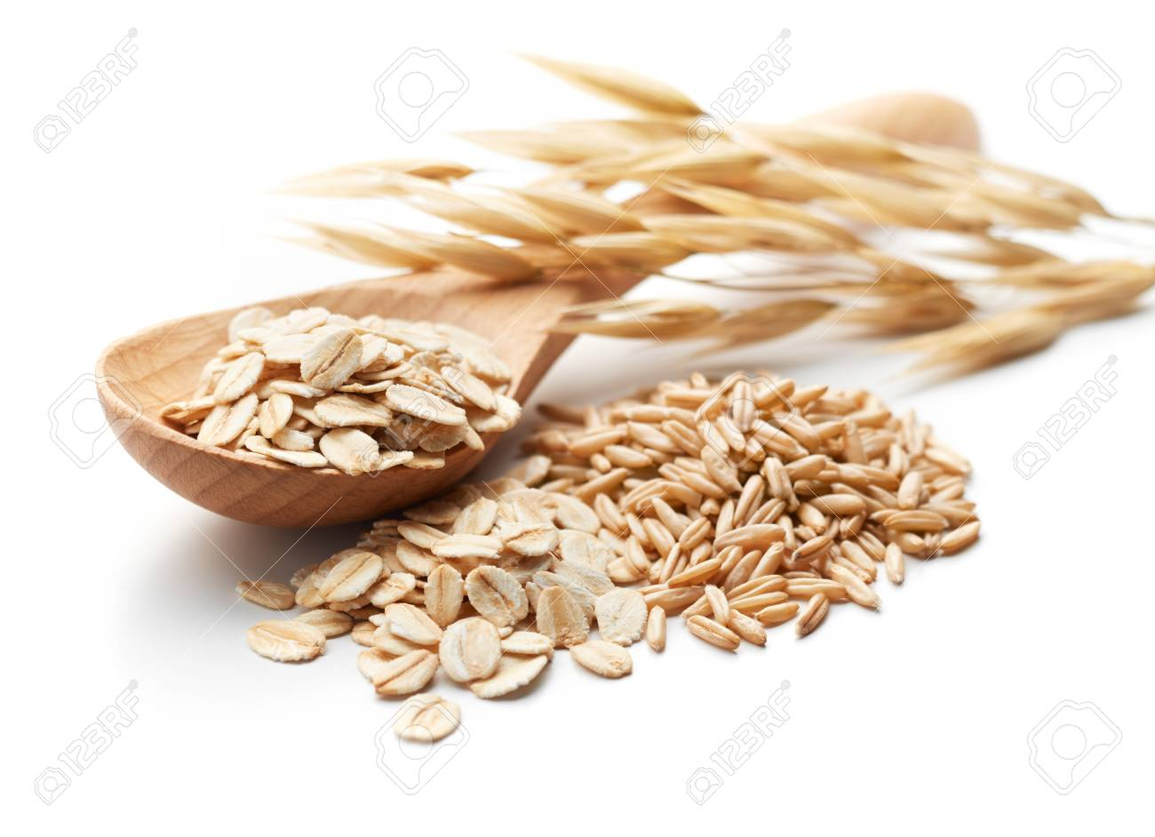 scoop and pile of oatmeal with its unprocessed grains and plant - 92489617