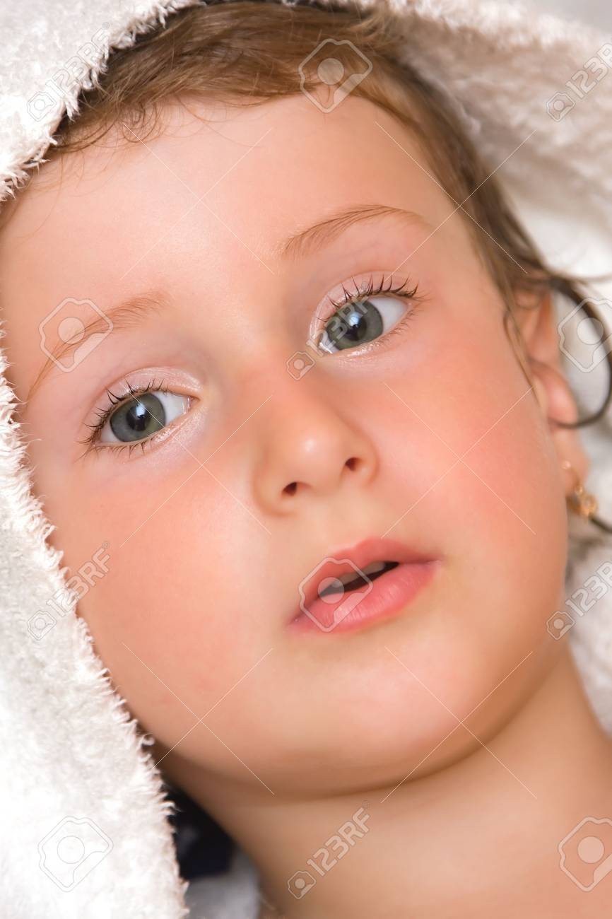 Young  girl wrapped up in a bath towel. Stock Photo - 3490905