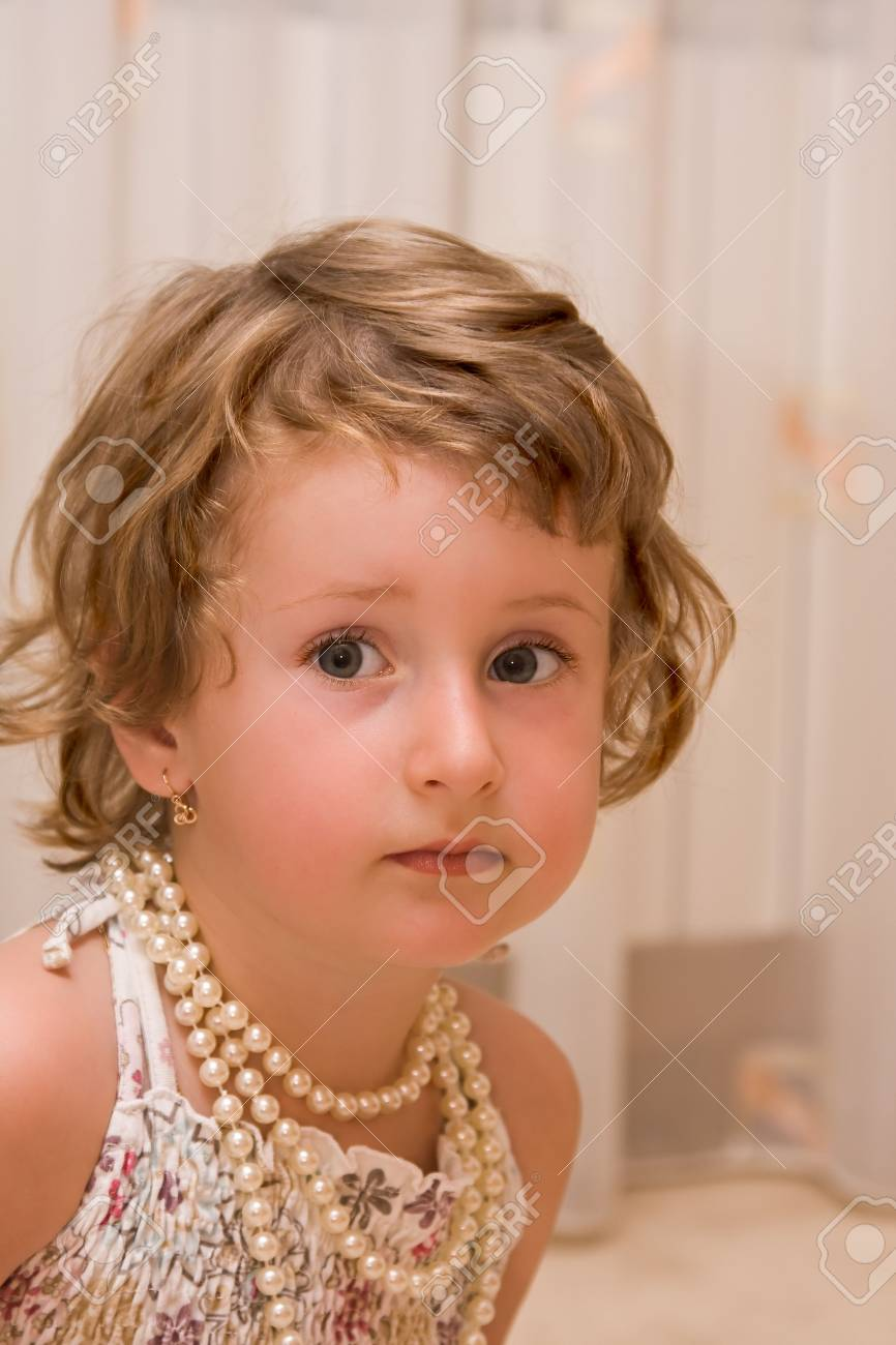 Serious young lady dressing up. Stock Photo - 3490904